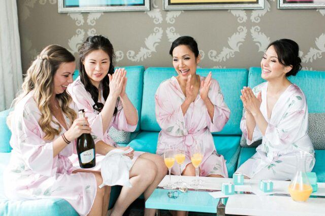 bridal party getting wedding ready in satin robes