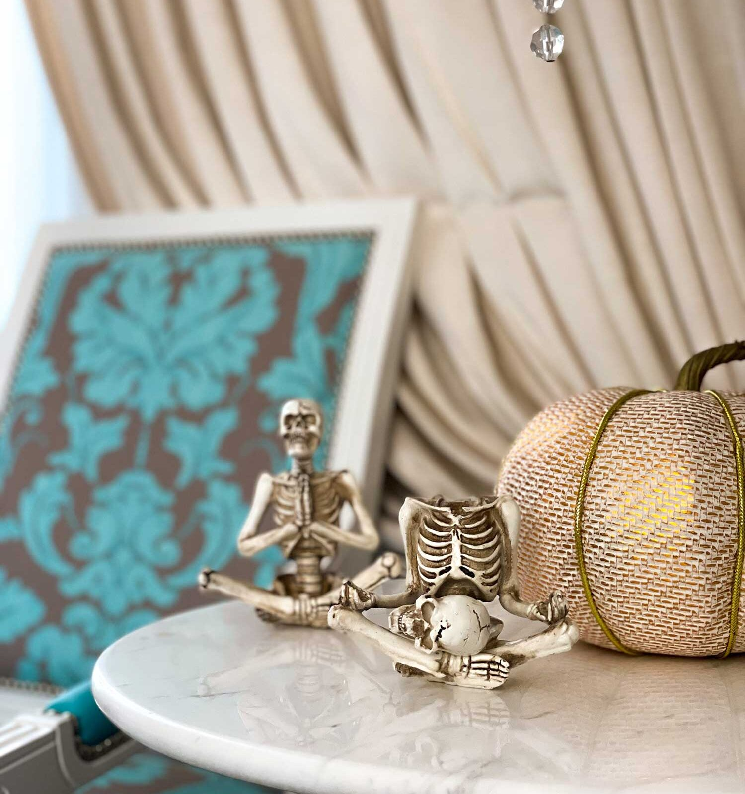 skeleton and pumpkin ornament on top of a table