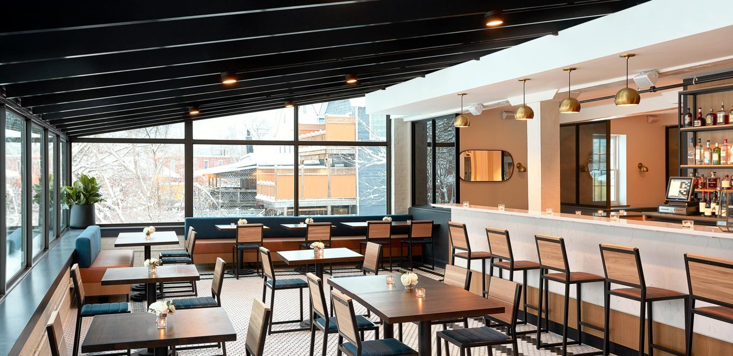 restaurant dining room with tables and bar area