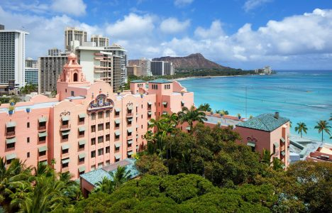 pink building near body of water during daytime