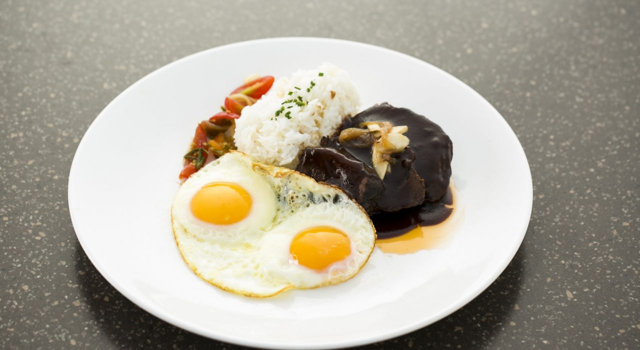 eggs and rice on a white plate close-up photography