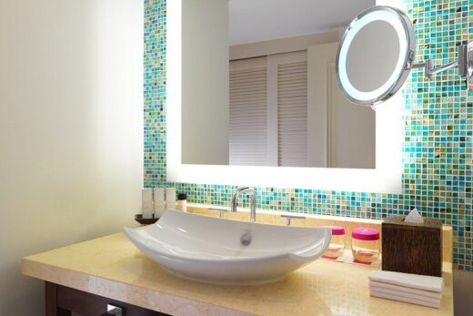 white ceramic sink and vanity mirror
