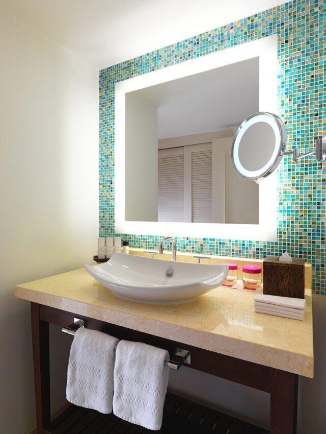 white ceramic sink and vanity mirror