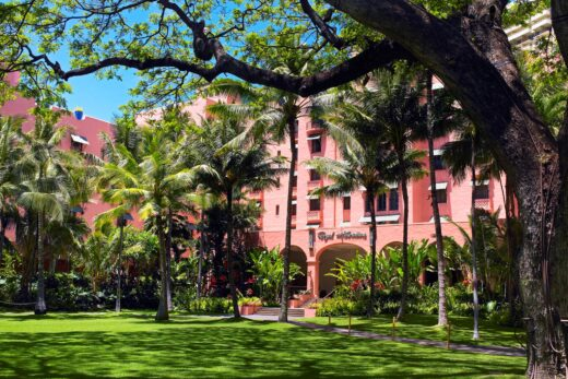 green coconut palm trees in front of The Royal Hawaiian