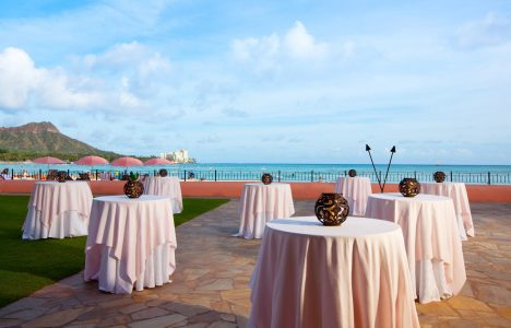 pink tables with ocean view in the background