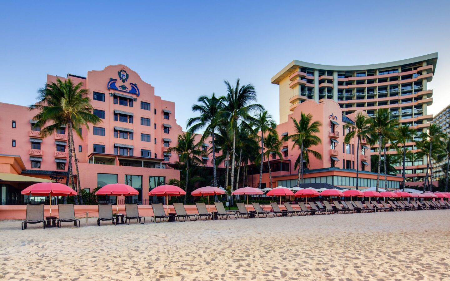 lounge chairs setup on beach in front of The Royal Hawaiian