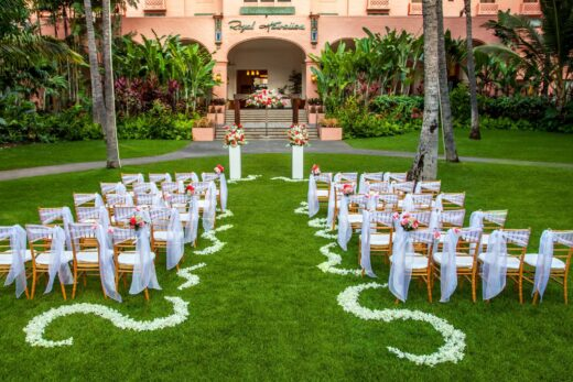 brown wooden white padded chairs during daytime for wedding
