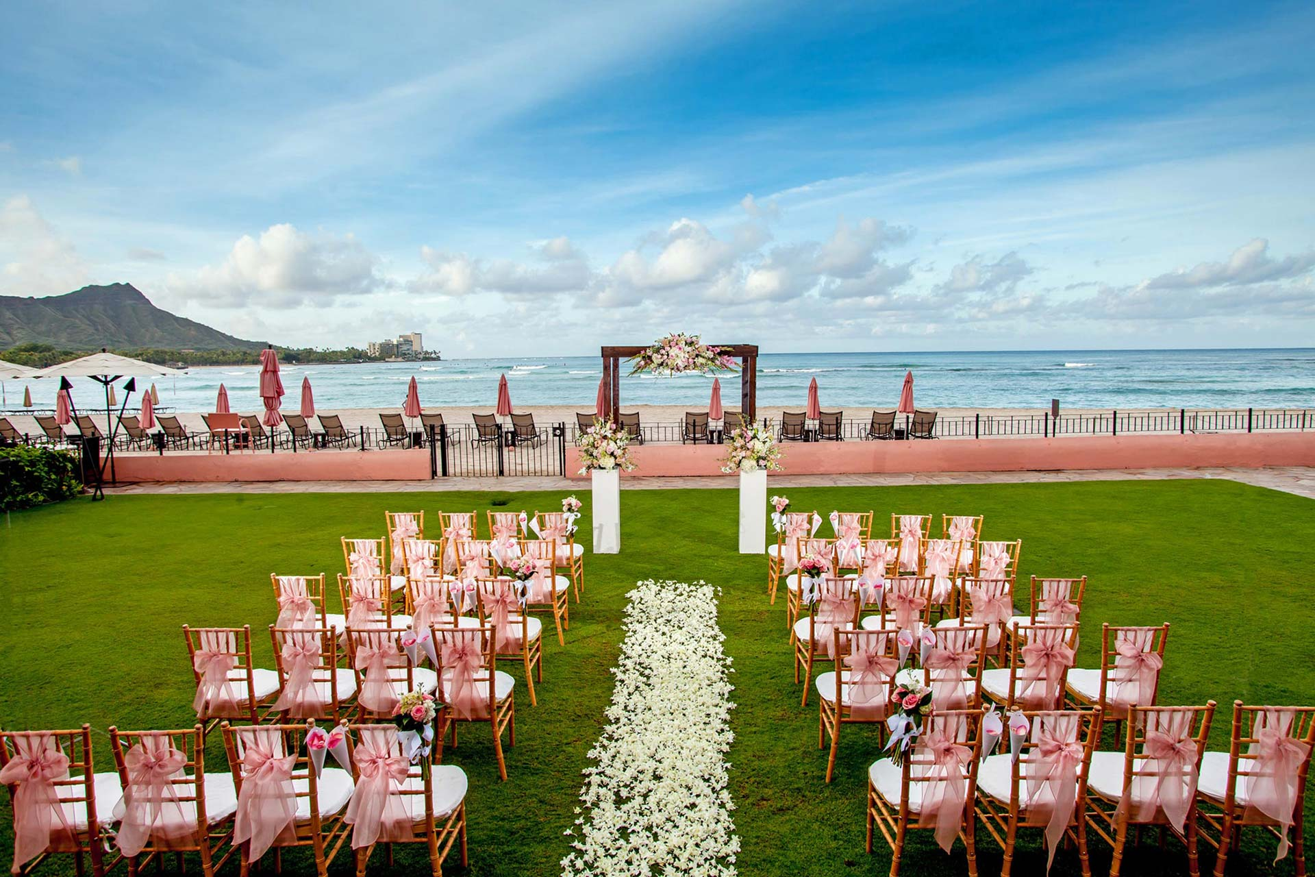 chairs and arbor setup for wedding with ocean in the background
