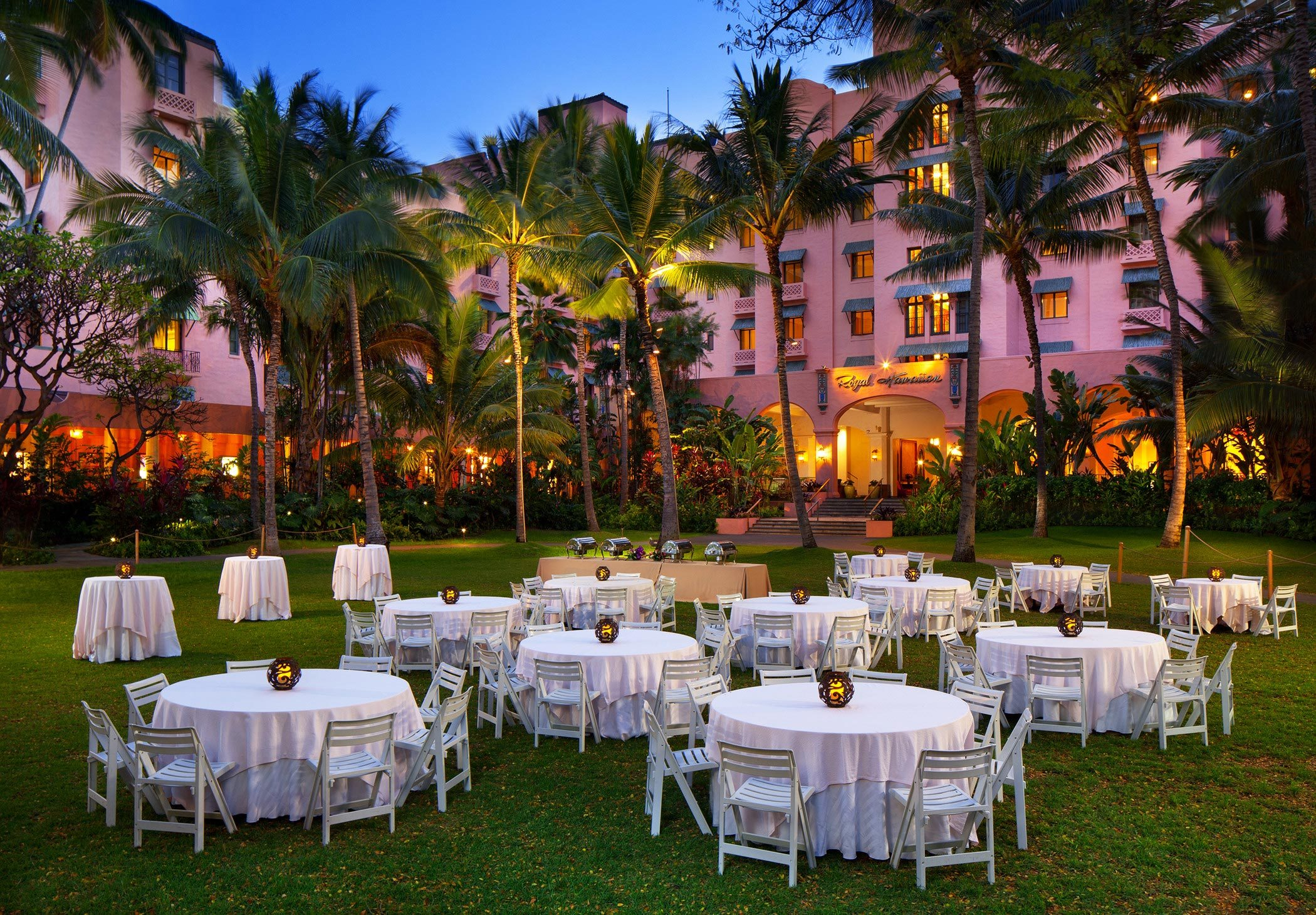 white table set in front of The Royal Hawaiian