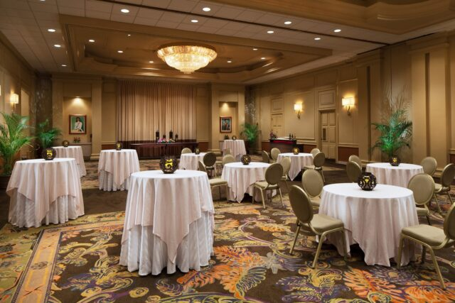 white tables and chairs in ballroom