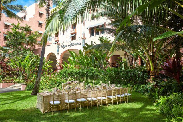 rectangular beige wooden dining set beside trees