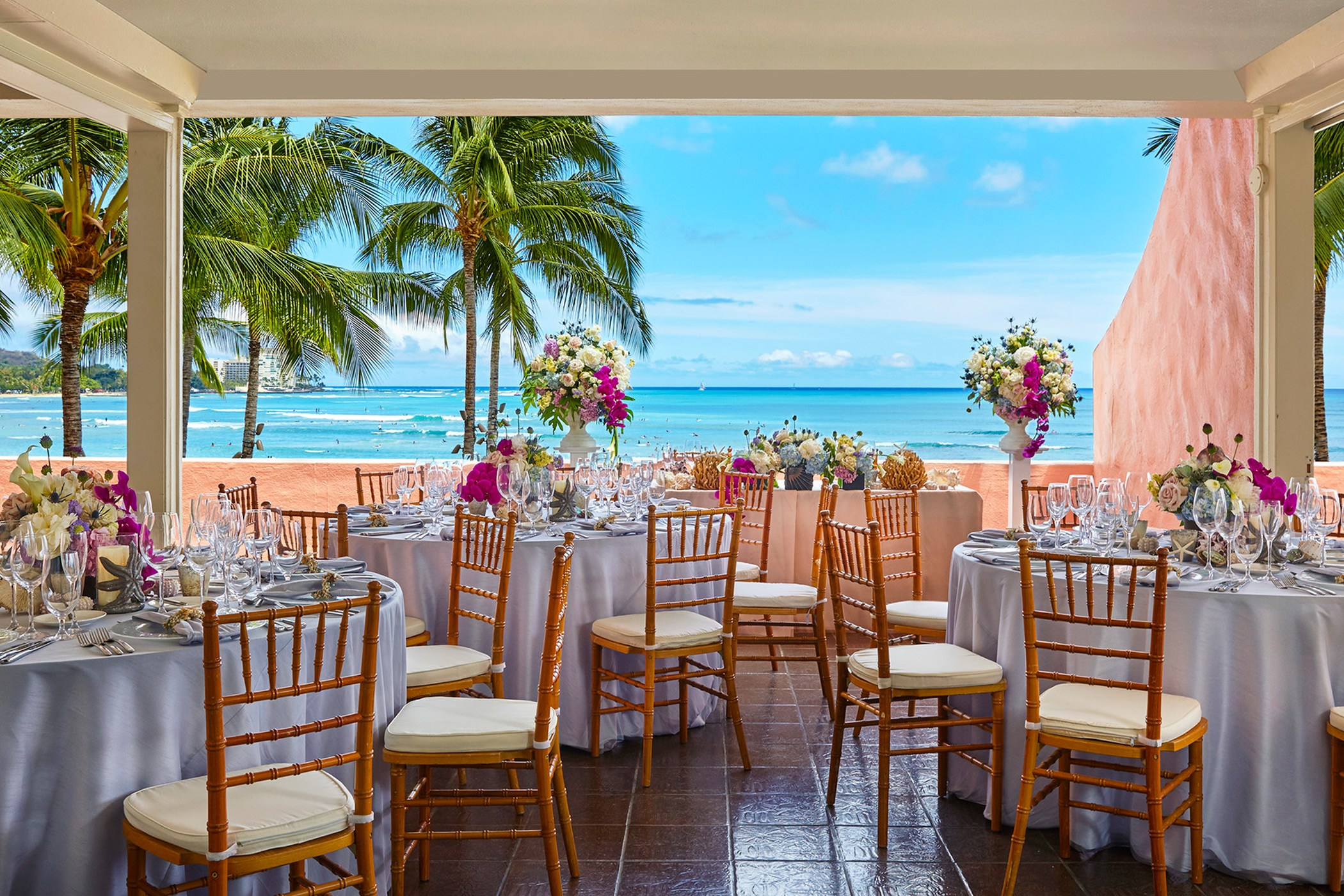 dining tables with bamboo chairs and ocean front view