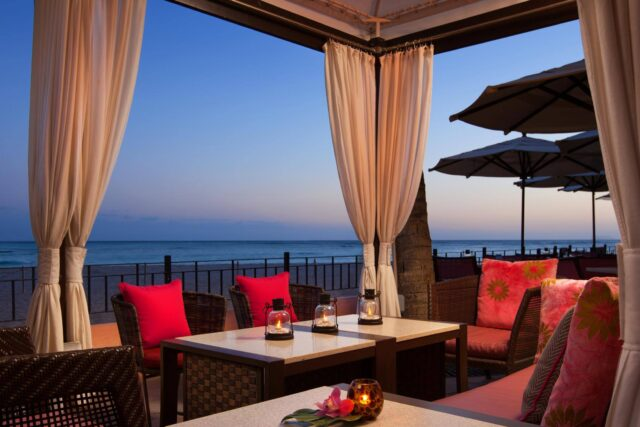 private oceanfront cabana with chairs and table