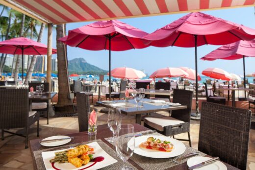 pink umbrellas with tables and chairs