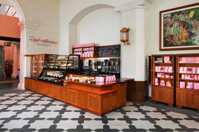 an overview of the bakery space in a brown cash counter on the left along with a shelve for bakery goods and drinks to go