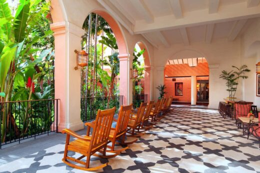 brown rocking chairs in open air hotel interior
