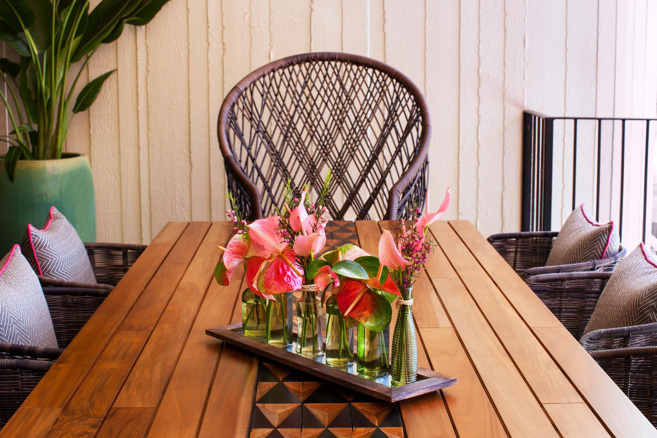 pink flowers in clear glass vases on table