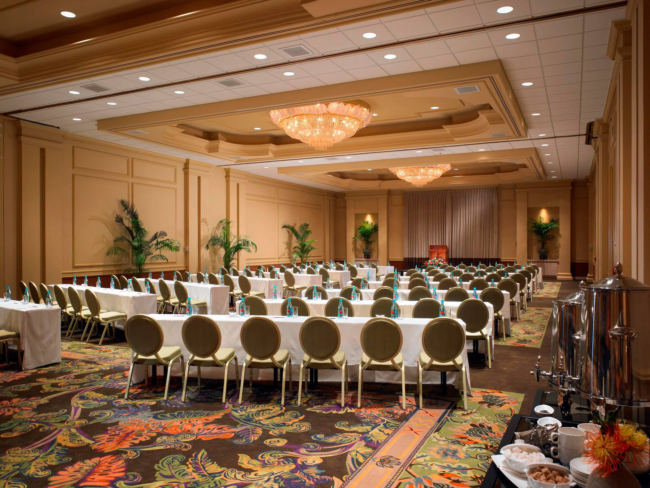 empty tables and chairs in ballroom