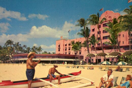 historic photo of people on beach in front of The Royal Hawaiian