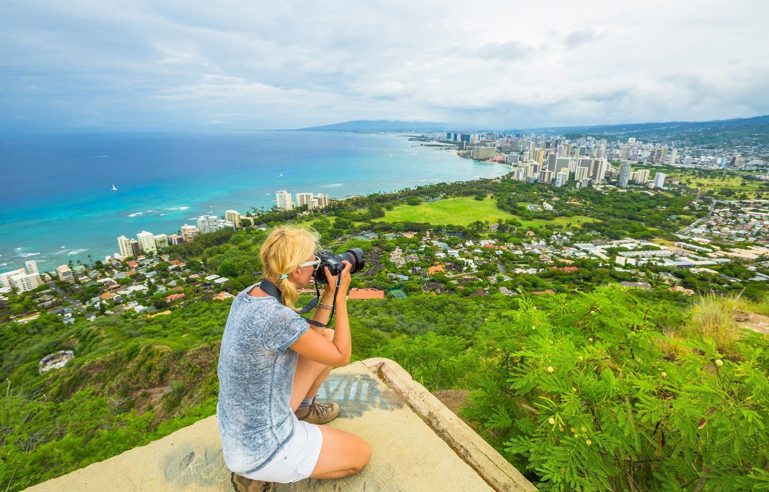 woman holding DSLR camera taking photo from top diamond head