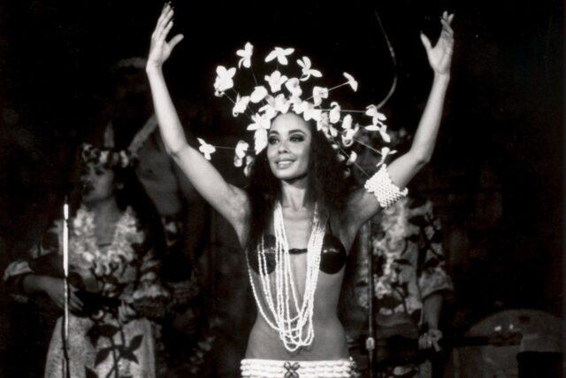 grayscale photo of woman hula dancer