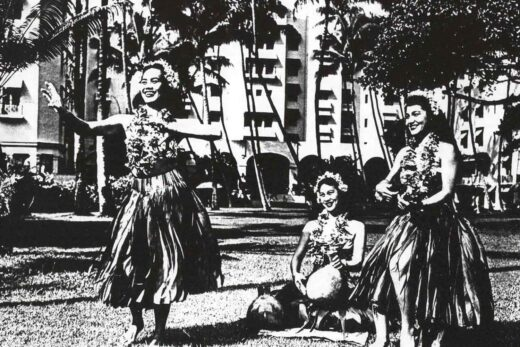 grayscale photo of women on grass field