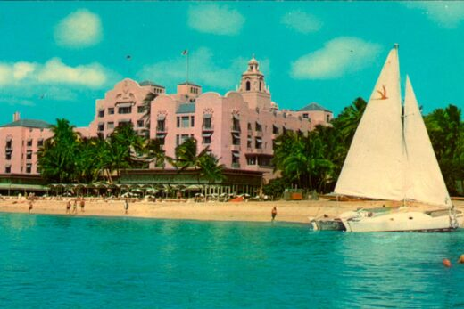 historic photo of royal hawaiian exterior with white sailboat