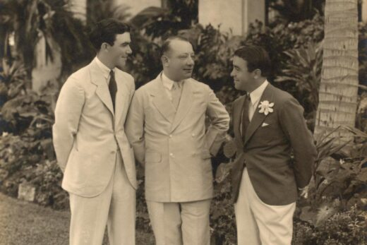 old photograph of three men standing outdoors