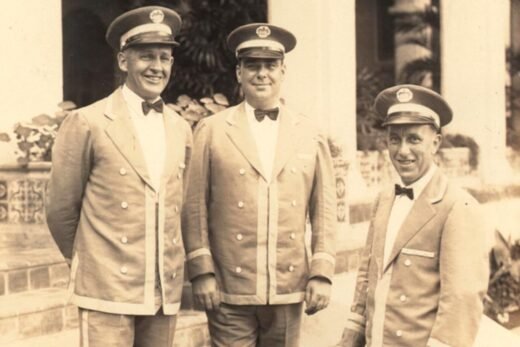sepia colored picture of three men in uniforms