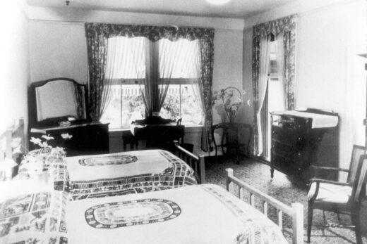 greyscale photography of bedroom