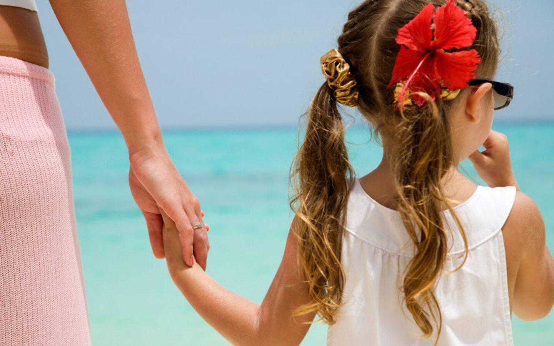 girl wearing white shirt walking on seashore