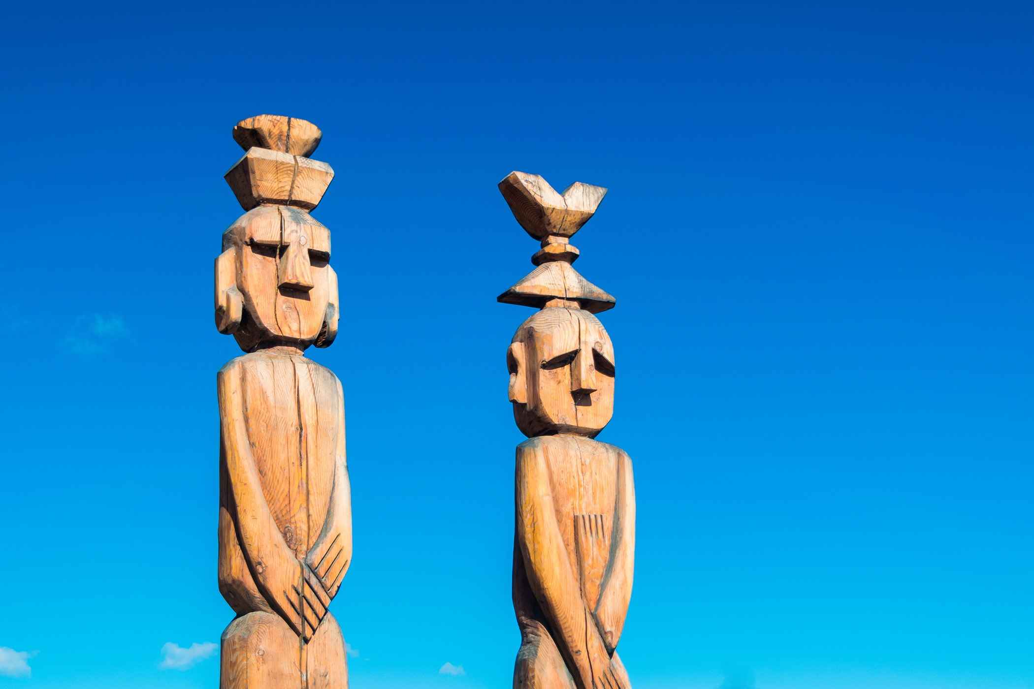 two brown wooden statues