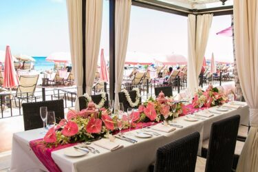 restaurant dining table with fresh flowers with ocean views