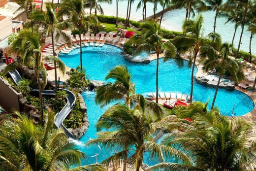 aerial view photo of swimming pool besides seashore