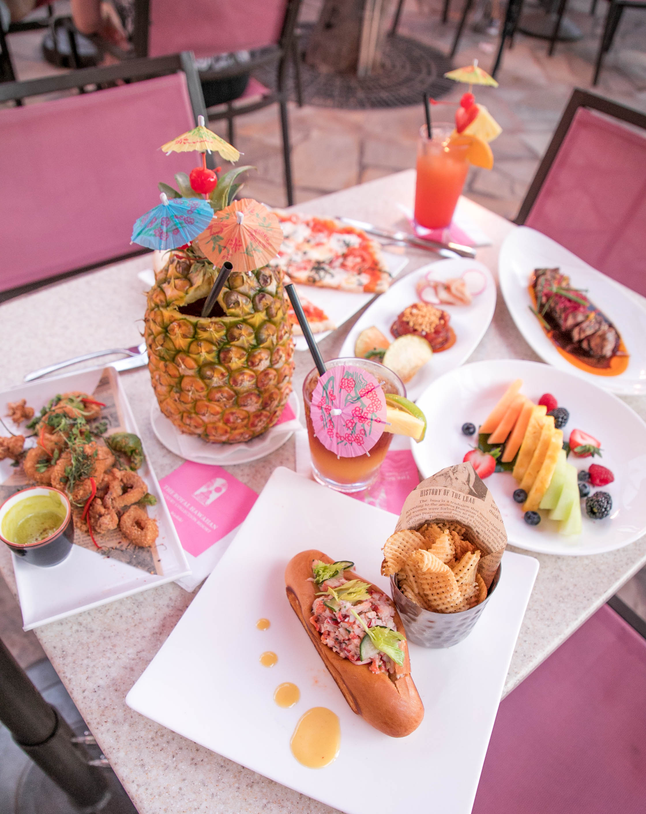 variety of food and tropical drinks on a table