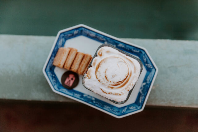 rectangular blue and white ceramic tray with bread and white cream