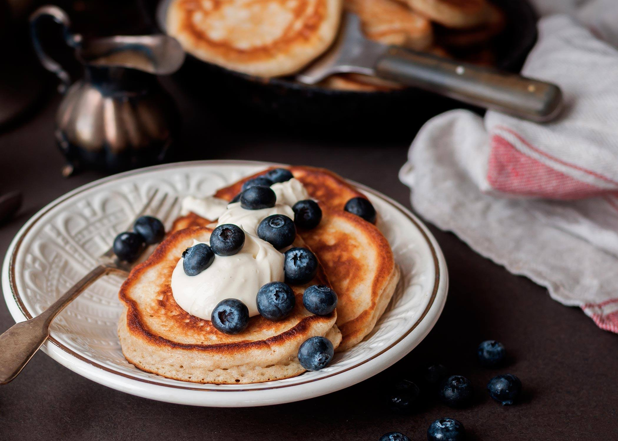 pancakes with blueberries and whipped cream