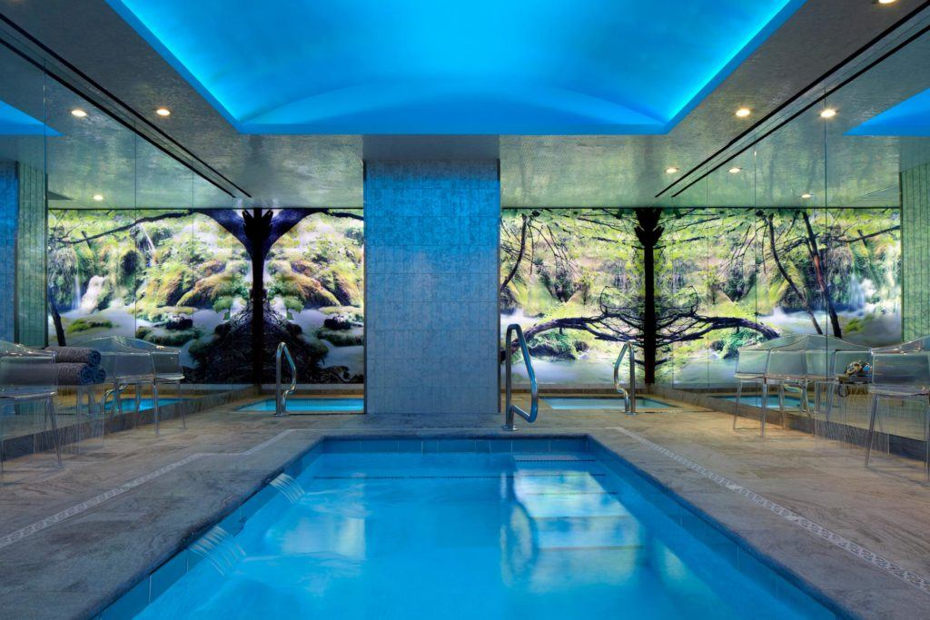 Indoor pool with blue ceiling