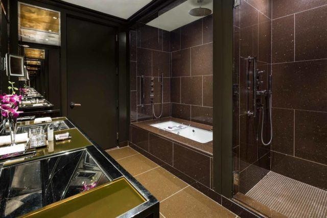 Larger bathroom with two sinks, shower and bathtub