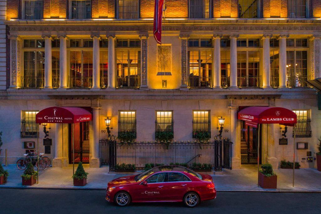 Hotel Exterior with Mercedes Benz House Car at night
