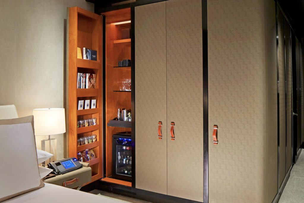 Closet with door open showing room amenities and bar fridge