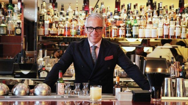 Chef Geoffrey Zakarian behind a bar