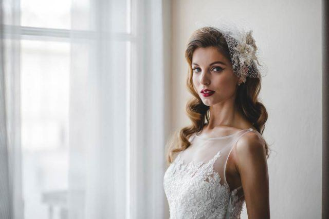A young beautiful bride getting ready at a hotel room