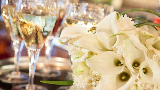 Wine in glasses with white flowers
