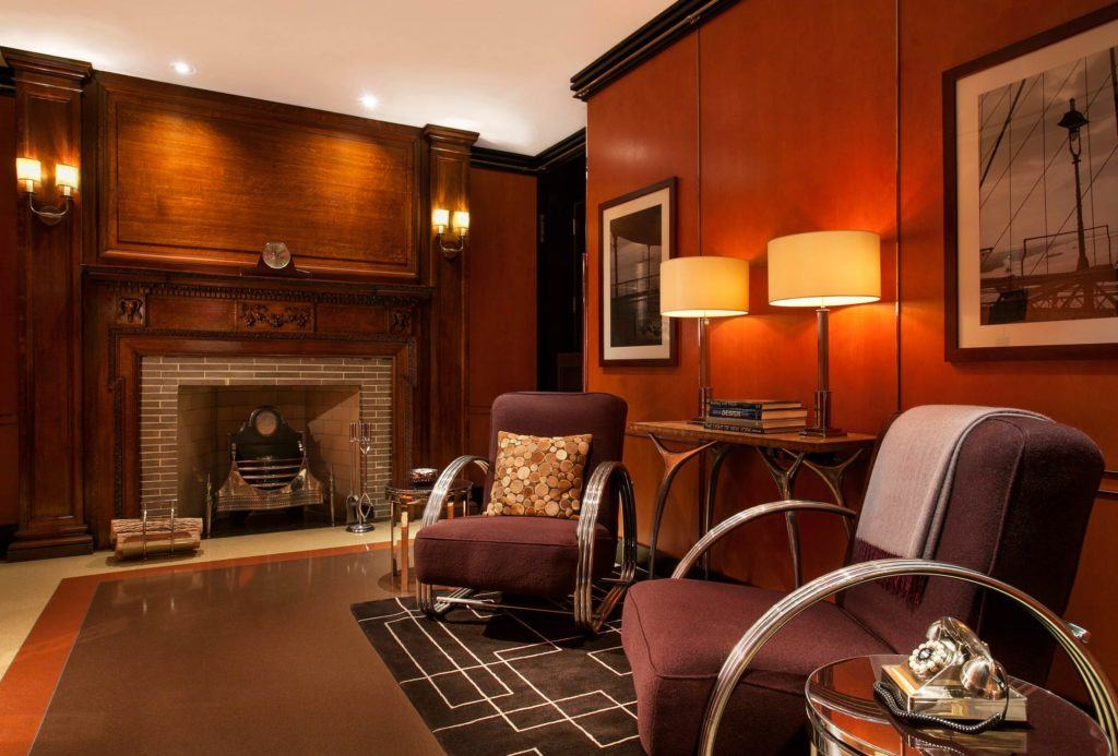 Hotel Foyer with wood panelling, fireplace and comfortable chairs
