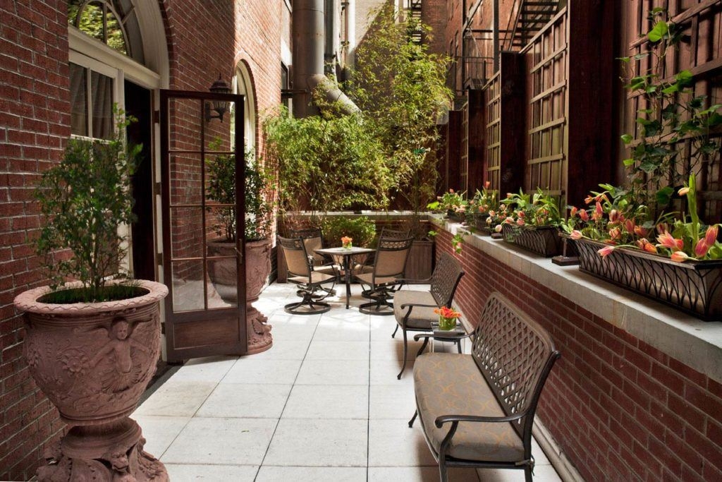 Large terrace with outdoor furniture and large planters