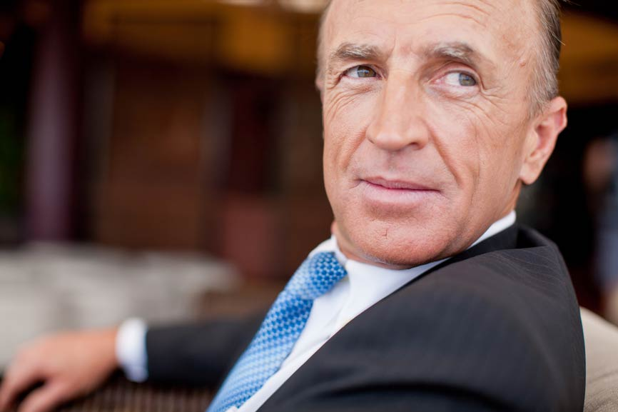 A pensive businessman, facing the camera but looking camera right