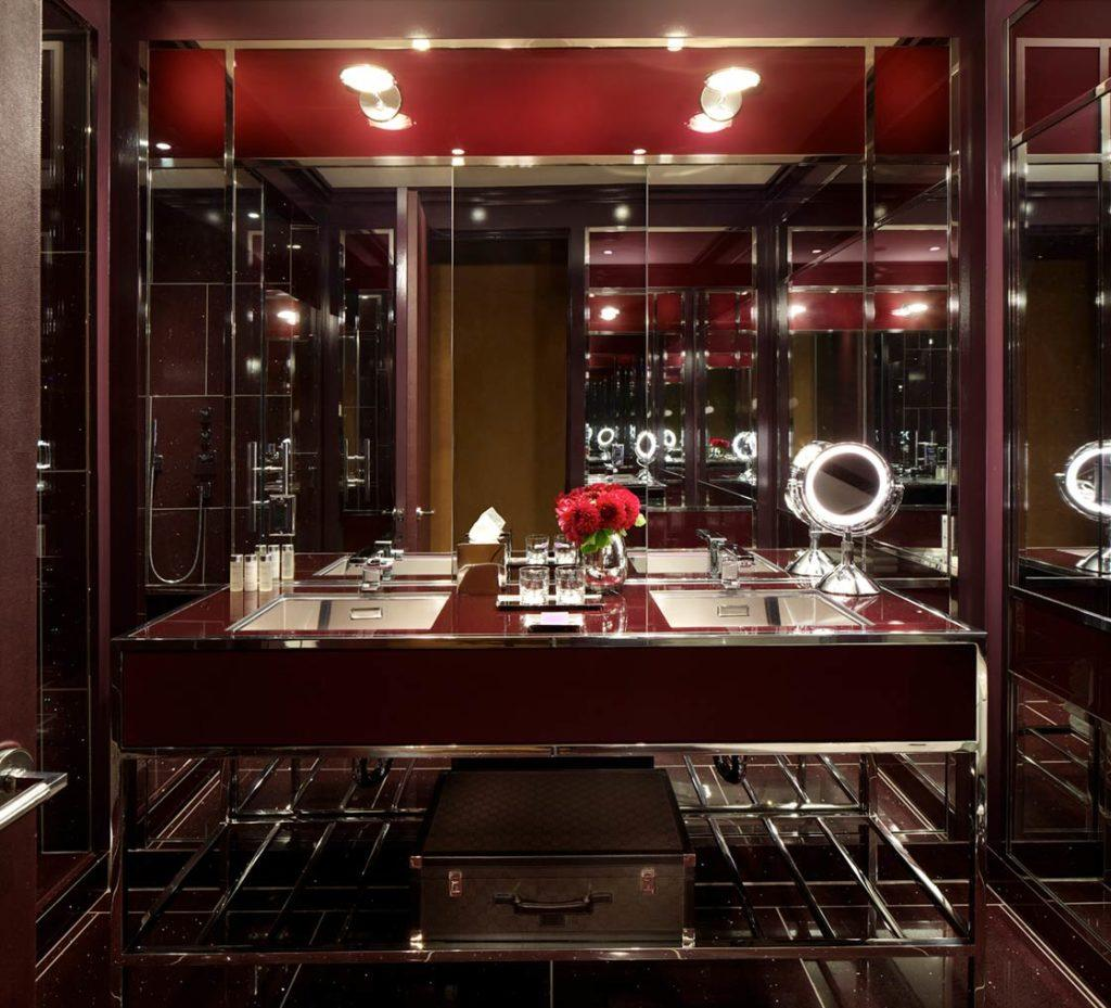 Bathroom with ruby colored double sink