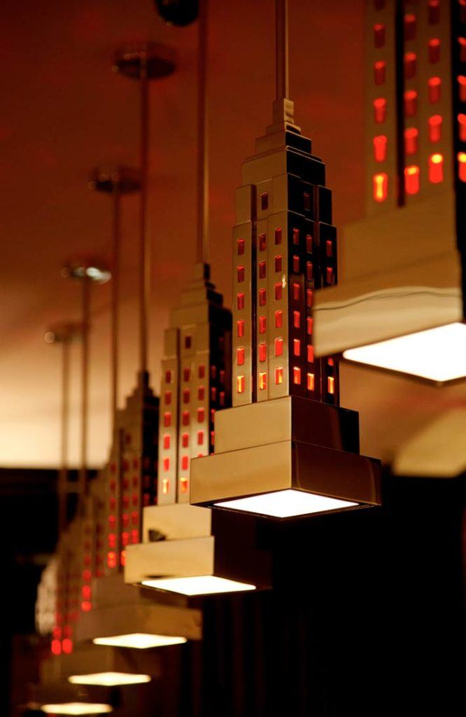 Hanging light fixtures in the shape of the Empire State Building