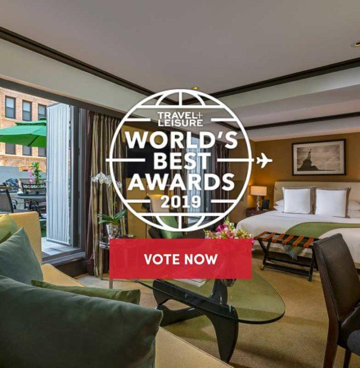 luxury hotel room with travel and leisure world's best awards 2019 logo overlaid